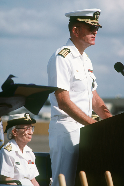 Captain Charles T. Smith, commanding officer, Navy Regional Data Automation Center, San Diego, speaks during the groundbreaking of the Grace M. Hopper Navy Regional Data Automation Center. Seated behind Captain Smith is Commodore Grace M. Hopper, special assistant to the commander, Naval Data Automation Command