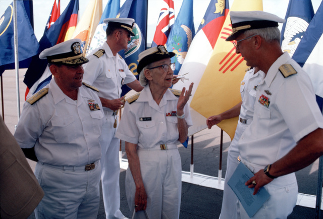 Commodore Grace M. Hopper, Special Assistant to the Commander, Naval Data Automation Command, speaks to Rear Admiral John W. Nyquist, Director, Surface Combat Systems, Office of the CHIEF of Naval Operations, and Rear Admiral Paul E. Sutherland Jr., Commander, Naval Data Automation Command, Washington, District of Columbia, during the groundbreaking of the Grace M. Hopper Navy Regional Data Automation Center. Captain C. T. Smith, Commanding Officer, Navy Regional Data Automation Center, is standing in the background
