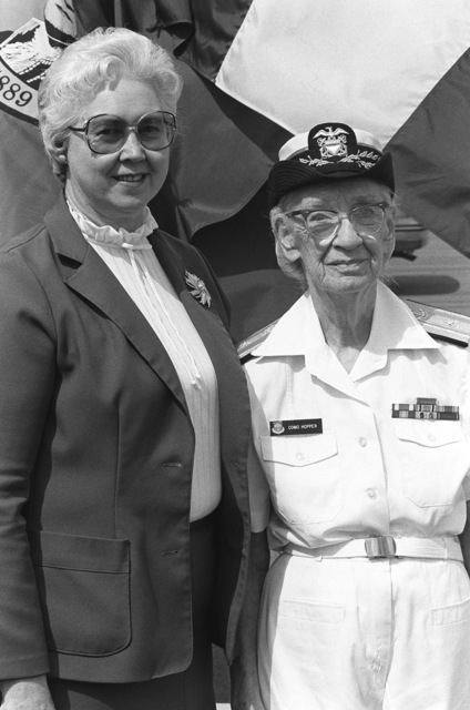 Commodore Grace M. Hopper, special assistant to the commander, Naval Data Automation Command (right), poses beside Eva M. Sebastion, project manager of the Navy Regional Data Automation Center, San Diego, during the groundbreaking of the Grace M. Hopper Navy Regional Data Automation Center