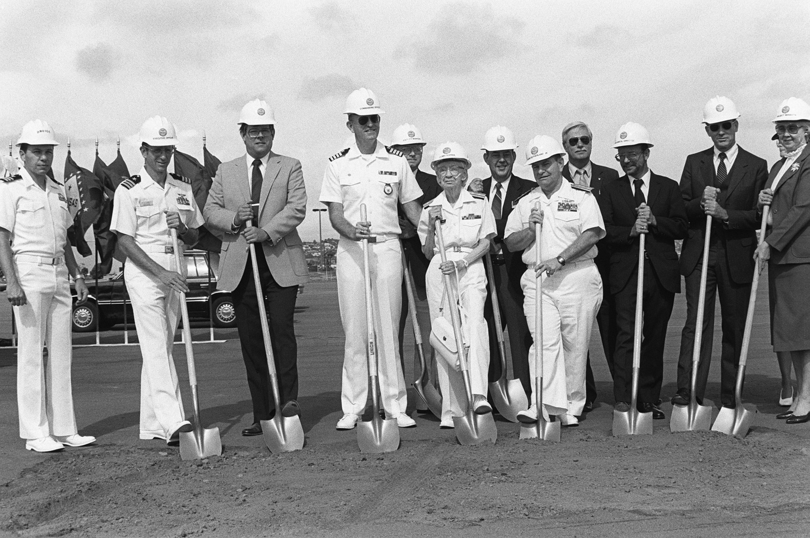 Members of the Military Construction Steering Committee pose during the groundbreaking of the Grace M. Hopper Navy Regional Data Automation Center. Members include Captain Robert L. Barton (fourth from left), Commodore Grace M. Hopper, special assistant to the commander, Naval Data Automation Command (center); Rear Admiral Paul Sutherland Jr., commander, Naval Data Automation Command; (front row right) and Project Manager Eva M. Sebastian (far right)