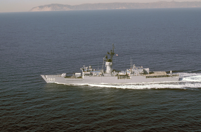 Aerial port beam view of the frigate USS LANG (FF 1060) underway