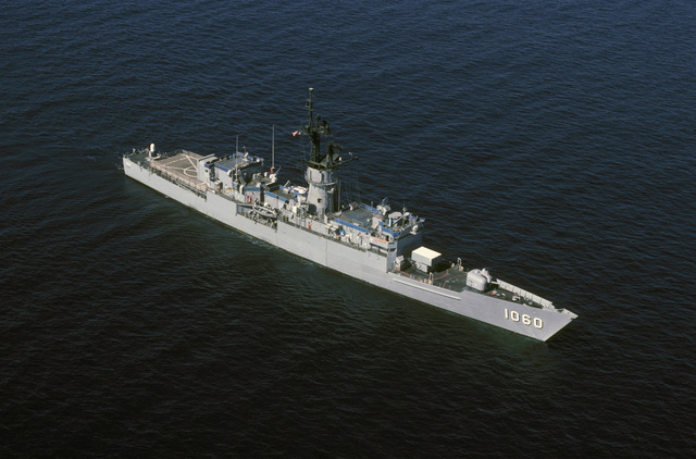 High angle starboard bow view of the frigate USS LANG (FF 1060) underway