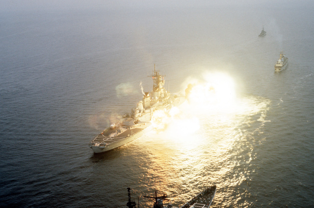 The battleship USS IOWA (BB 61) fires its Mark 7 16-inch/50 caliber guns from the No. 1 and No. 2 turrets while underway in formation with task force ships participating in the multilateral NATO exercise BALTOPS '85