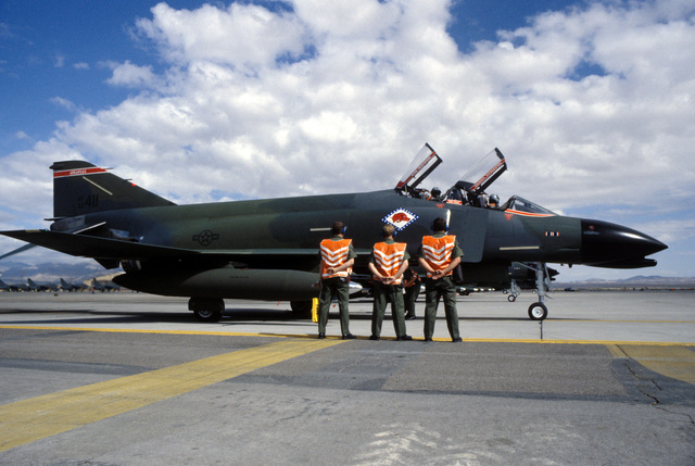 Ground crewmen stand by as the aircrew of an F-4C Phantom II aircraft prepares for a mission during Exercise GUNSMOKE '85
