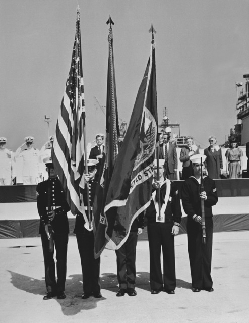 A joint Navy and Marine honor guard participates in the christening ceremony for the Aegis guided missile cruiser MOBILE BAY (CG-53). They are armed with M-14 rifles. Behind them is Rear Adm. W. Meyer, deputy commander, Combat Systems, Naval Sea Systems Command, (left) and Sen. Jeremiah Denton Jr., R-Ala., (center)
