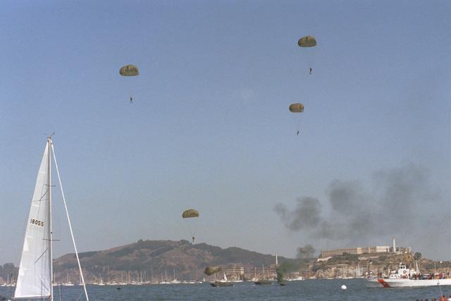 A Navy Sea-Air-Land (SEAL) team members parachute into the bay during Fleet Week activities