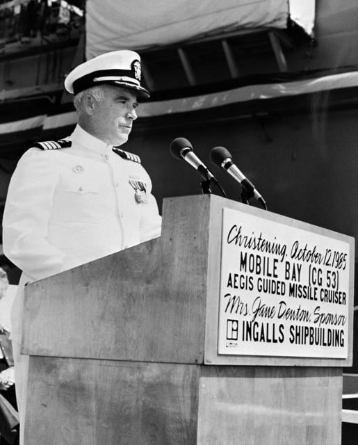 CAPT. George W. Dowell III, supervisor of shipbuilding, conversion, and repair, Pascagoula, speaks during the christening ceremony for the Aegis guided missile cruiser MOBILE BAY (CG-53)
