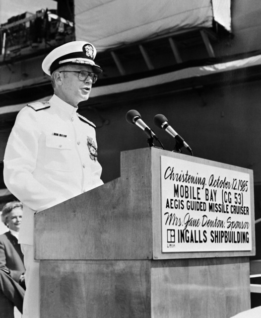 Commodore John F. Shaw, program manager, Aegis Shipbuilding, Naval Sea Systems Command, speaks during the christening ceremony for the Aegis guided missile cruiser MOBILE BAY (CG-53)