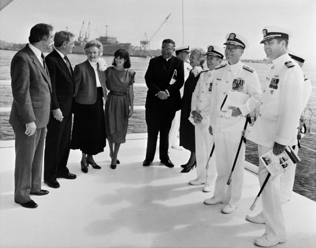 Members of the christening party attending the ceremony for the Aegis guided missile cruiser MOBILE BAY (CG-53) are (L-R): Mr. J. St. Pe'; Sen. J. Denton Jr., R-Ala., Miss E. Denton, maid of honor; Archbishop O. Lipscomb; Rear Adm. W. Meyer, deputy commander, Combat Systems, Naval Sea Systems Command; Mrs. M. McPhillips, matron of honor; Vice Adm. J. Metcalf III, deputy chief of Naval Operations, Surface Warfare; Commodore J. Shaw, program manager, Aegis Shipbuilding, Naval Sea Systems Command; and Capt. F. Whalen, prospective commanding officer of the MOBILE BAY
