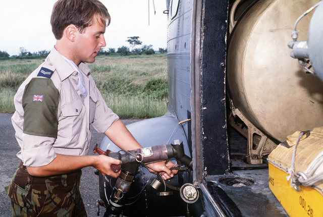 A member of the Royal Air Force refuels a helicopter during relief efforts for the victims of the Nevado del Ruiz volcano eruption