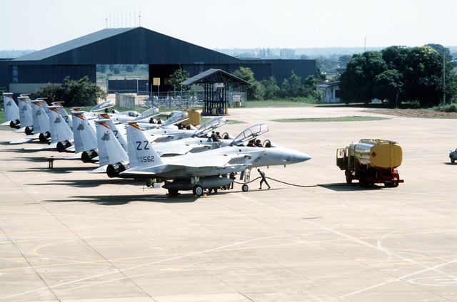 Royal Thai Air Force petroleum, oil and lubricant technicians refuel a 67th Tactical Fighter Squadron F-15 Eagle aircraft a after a mission. The U.S. and Thailand are participating in Commando West IX, a joint training exercise