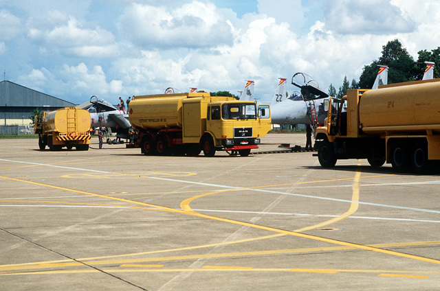 Royal Thai Air Force petroleum, oil and lubricant trucks refuel 67th Tactical Fighter Squadron F-15 Eagle aircraft after a mission. The U.S. and Thailand are participating in Commando West IX, a joint training exercise