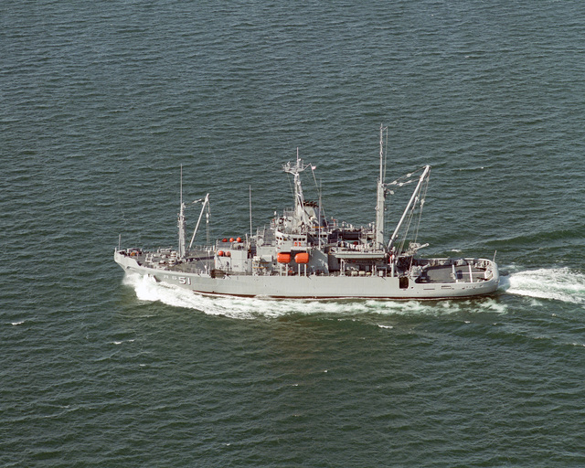 Aerial port beam view of the rescue/salvage ship USS GRASP (ARS 51) underway during sea trials