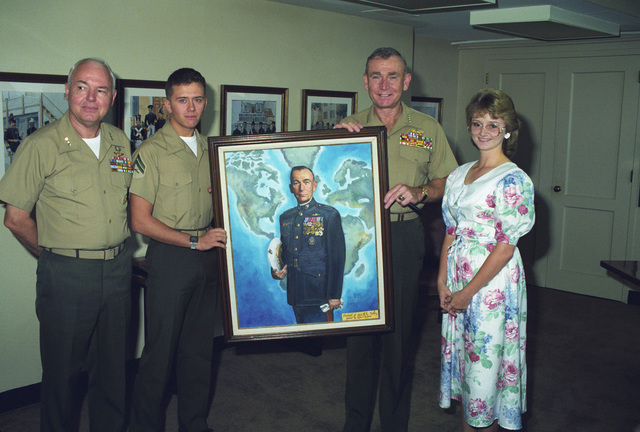 Corporal (CPL) Charles Grow presents a portrait he painted to General (GEN) P.X. Kelly, commandant of the Marine Corps. Theresa Grow and Lieutenant General (LGEN) D'Wayne Gray, commanding general, Fleet Marine Force Pacific, attend the presentation
