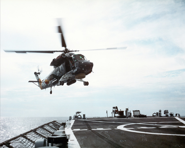 A right front view of an SH-2F helicopter from the Helicopter Light Antisubmarine Squadron 34 (HSL-34) approaching the deck of the guided missile frigate USS FAHRION (FFG 22) during deck landing qualifications. (SUBSTANDARD)