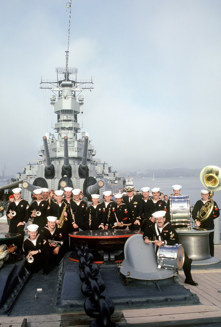 The Sixth Fleet Band poses for a photo on the bow of the battleship USS IOWA (BB-61) during the ship's port visit