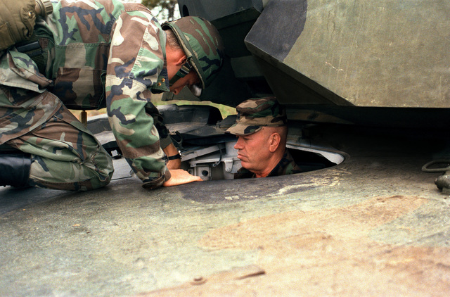 Sergeant Major Glen E. Morrell, Sergeant Major of the Army sits in the driver's compartment of an M1 Abrams main battle tank during his visit to the US Army Armor Center