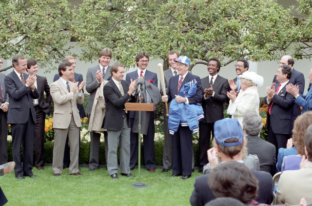President Reagan Receives a Royals Jacket, Hat and Bat from Manager Dick Howser during a Ceremony to Congratulate the 1985 World Series Champion Kansas City Royals Baseball Team in the Rose Garden