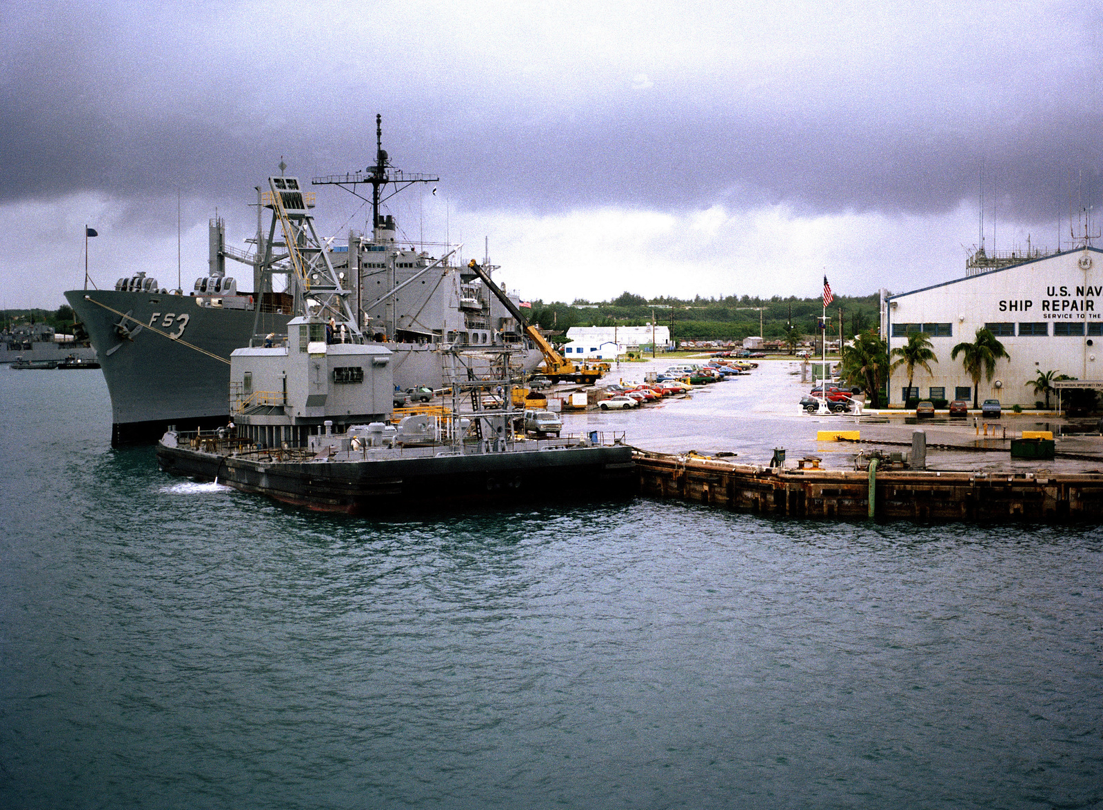 A view of a section of the US Naval Ship Repair Facility with the combat stores ship USS NIAGARA FALLS (AFS 3) moored at left