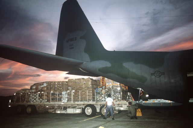 Medical supplies are loaded onto an Air Force Reserve C-130 Hercules aircraft for shipment to San Salvador, El Salvador.  The cargo is part of a package of humanitarian aid provided by private US organizations under the authorization of the Denton Agreement