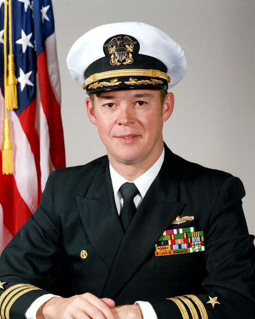Commander (CDR) Thomas R. Mooney, USN (covered)