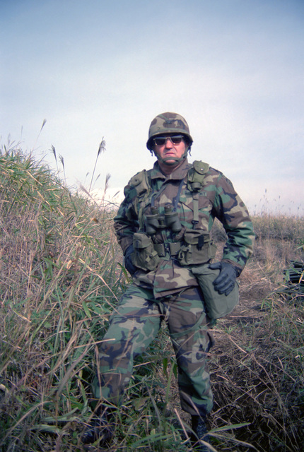 Colonel (COL) Thomas B. Vaughn, commander, 1ST Brigade, Task Force Lancer, observes his troops during the joint US/Japanese Exercise ORIENT SHIELD '85