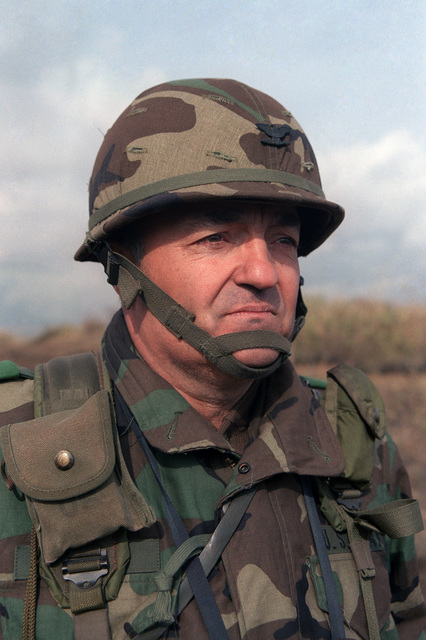 Colonel (COL) Thomas B. Vaughn, commander, 1ST Brigade, Task Force Orient Shield, observes the training of his soldiers during Exercise ORIENT SHIELD