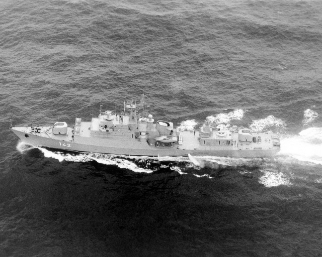 Aerial port beam view of a Soviet Koni class frigate armed with one twin SA-N-4 missile launcher, two twin 76 mm dual purpose guns and two twin 30 mm guns. (SUBSTANDARD)