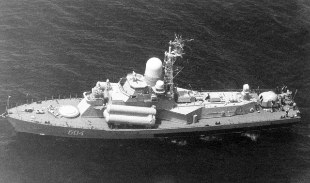 Aerial port beam view of a Soviet Nanuchka class guided missile patrol boat armed with a twin SA-N-4 antiaircraft missile launcher and a twin 57 mm gun aft. (SUBSTANDARD)