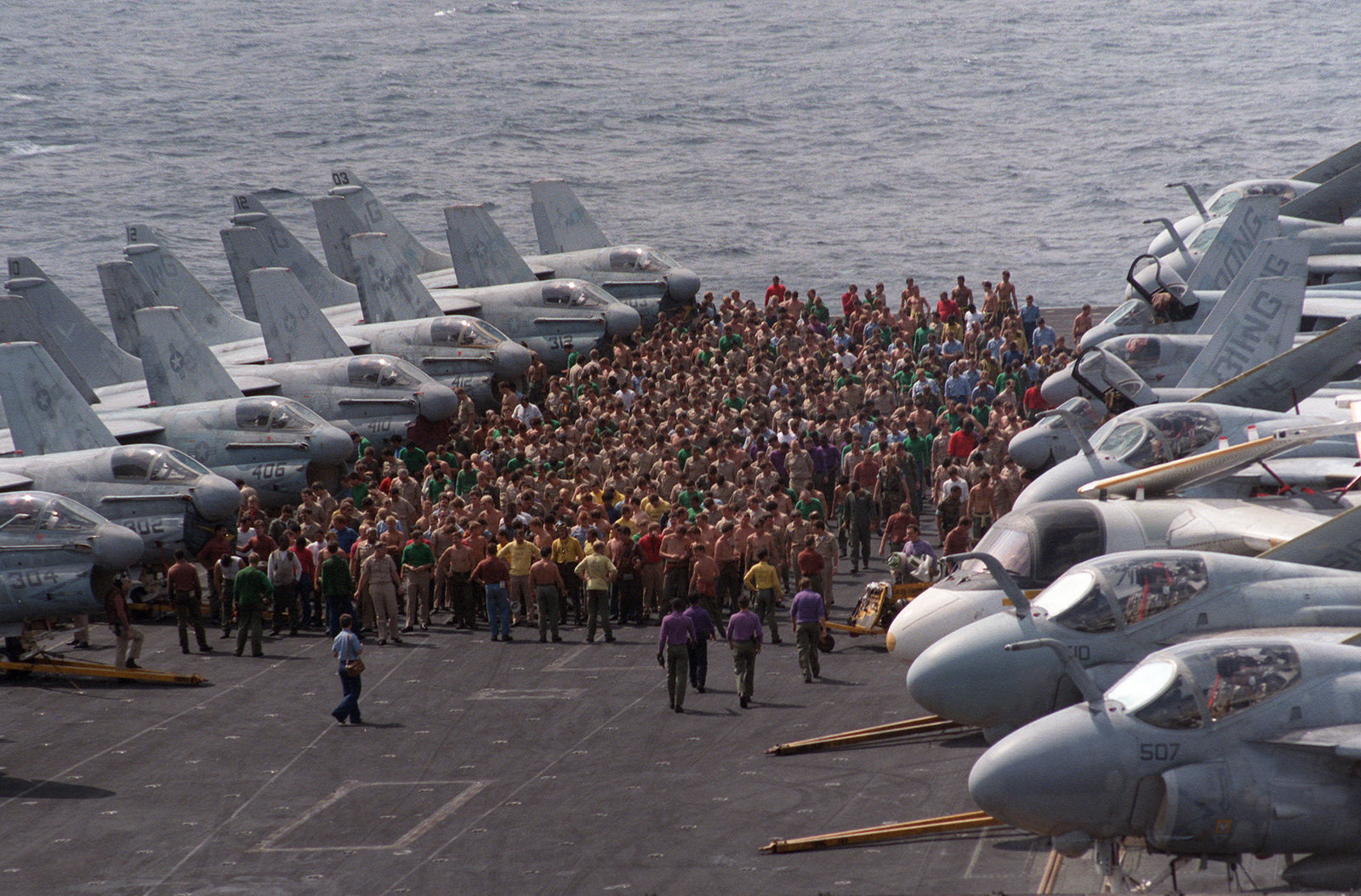 crew members muster on the flight deck during a foreign object damage  fod  walk aboard the