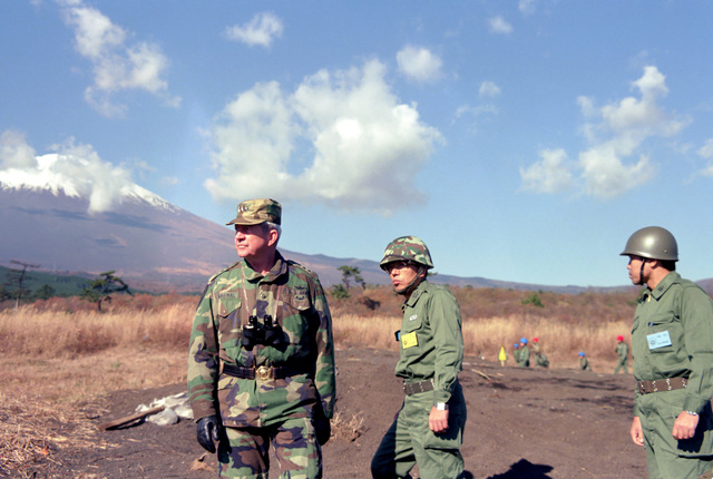 Lieutenant General (LGEN) Charles W. Bagnal, commander, US Army Western Command, and two Japanese officers observe troop movements during the joint US/Japanese Exercise ORIENT SHIELD '85