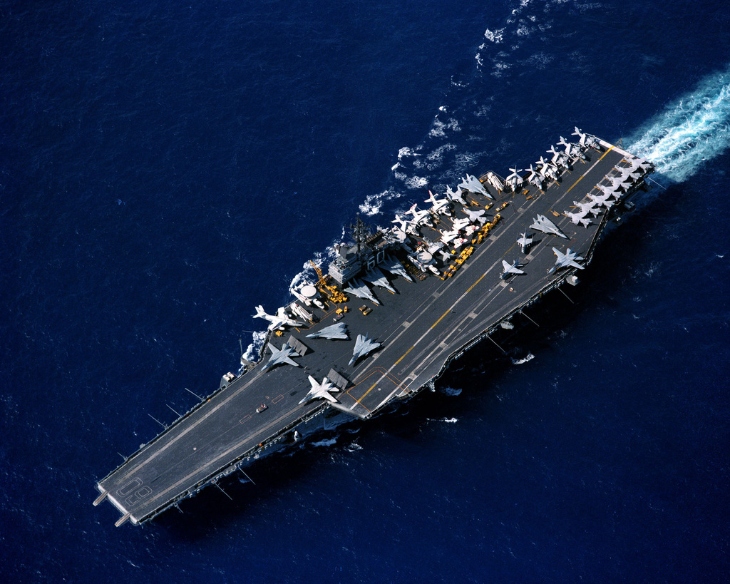 A high angle port bow view of the aircraft carrier USS SARATOGA (CV 60) underway