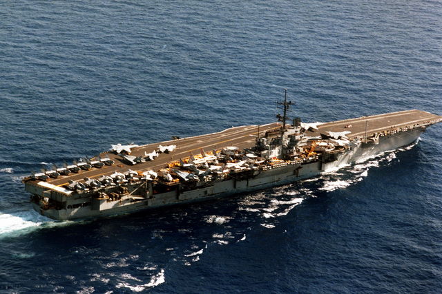 An elevated starboard quarter view of the aircraft carrier USS SARATOGA (CV-60) underway