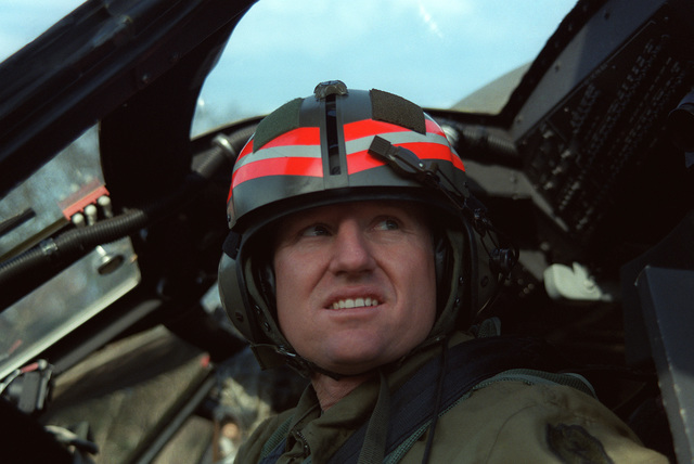 Captain (CPT) Chris Acker, operations officer, 17th Combat Aviation Company, 25th Aviation Brigade, 25th Infantry Division, prepares to take off on an air assault mission in a UH-60A Blackhawk (Black Hawk) helicopter during bilateral training Exercise ORIENT SHIELD