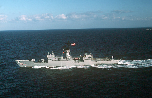 Aerial port beam view of the frigate USS DOWNES (FF 1070) underway
