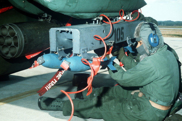 A 19th Aircraft Generation Squadron ground crewman loads BDU-33 practice bombs aboard an OV-10A Bronco aircraft during Exercise COPE MAX 85