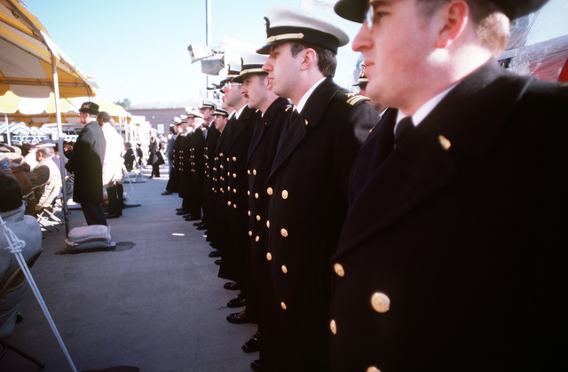 Naval officers stand at attention during the commissioning of the nuclear-powered attack submarine USS PITTSBURGH (SSN 720)