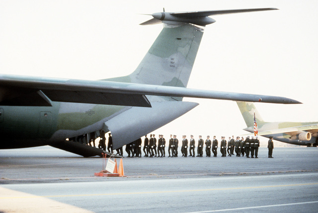 Members of the 101st Airborne Division Honor Guard board a 437th Military Airlift Wing C-141B Starlifter aircraft for a flight to Gander, Newfoundland, Canada, where they will assist in the airlift of remains of members of the 3rd Bn., 502nd Inf., 101st Airborne Div. On December 12, 1985, 248 soldiers of the 3rd Battalion were killed in a plane crash at the Gander Airport. They were returning to the United States after participating in peacekeeping duty with the Multi-national Force and Observers in the Sinai Desert
