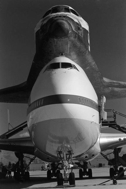A NASA 747 aircraft is serviced on the flight line during a stopover at the base.  The 747 is transporting the space shuttle Challenger to Cape Canaveral, Florida