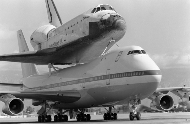 A NASA 747 aircraft transporting the space shuttle Challenger prepares to take off for Cape Canaveral, Florida, after a refueling stop at the base