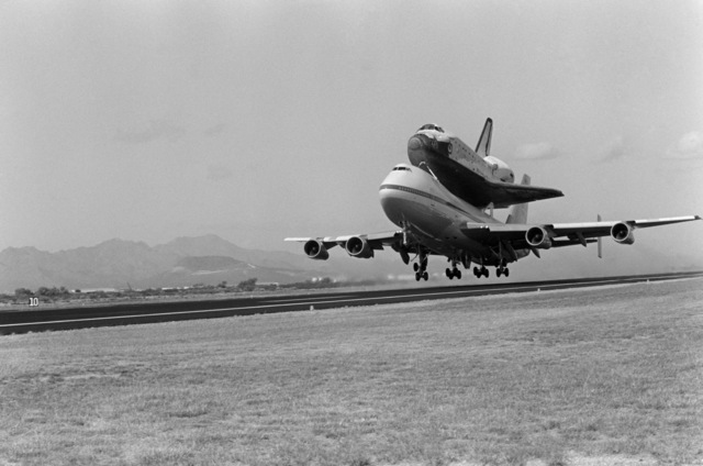 A NASA 747 aircraft transporting the space shuttle Challenger takes off for Cape Canaveral, Florida, after stopping at the base for refueling and minor maintenance