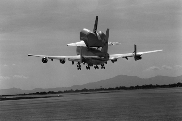 A NASA 747 aircraft transporting the space shuttle Challenger to Cape Canaveral, Florida, after stopping at the base for refueling and minor maintenance