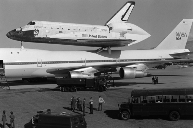 Ground crewmen refuel and service a NASA 747 aircraft during a stopover at the base.  The 747 is transporting the space shuttle Challenger to Cape Canaveral, Florida