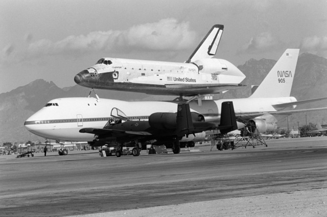 Ground crewmen refuel and service a NASA 747 aircraft during a stopover at the base.  The 747 is transporting the space shuttle Challenger to Cape Canaveral, Florida.  An A-10 Thunderbolt II aircraft is in the foreground