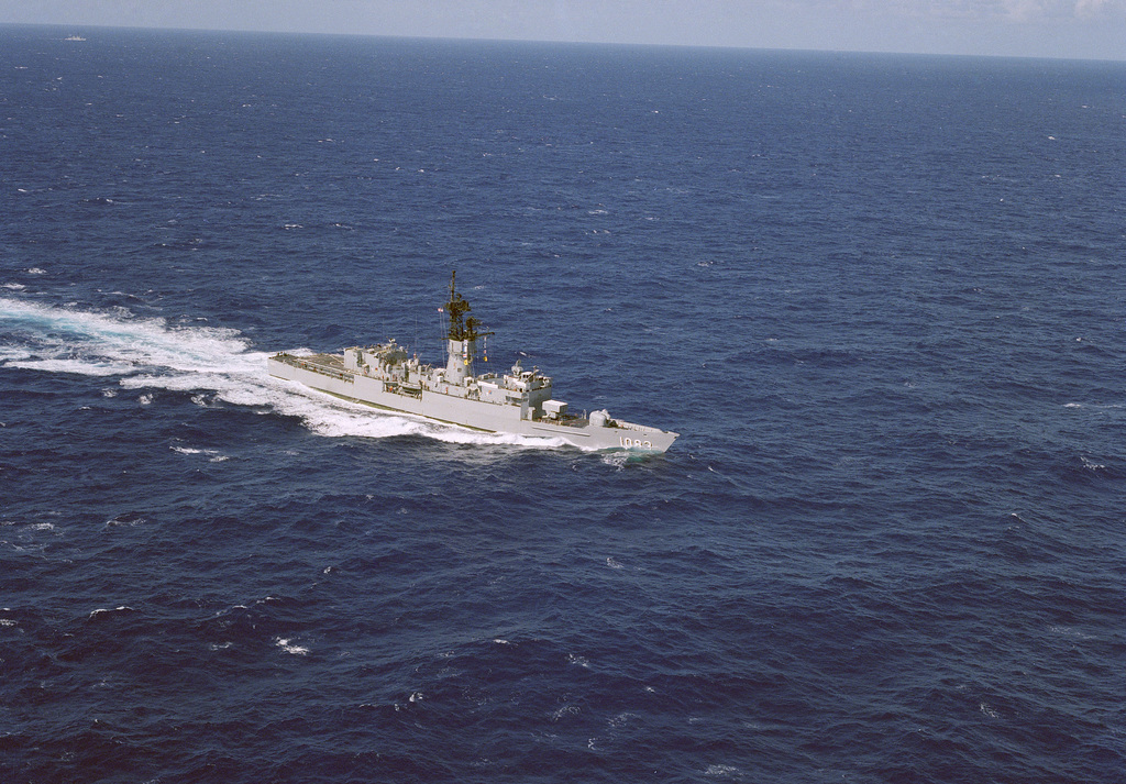 An aerial starboard bow view of the frigate USS COOK (FF 1083) underway