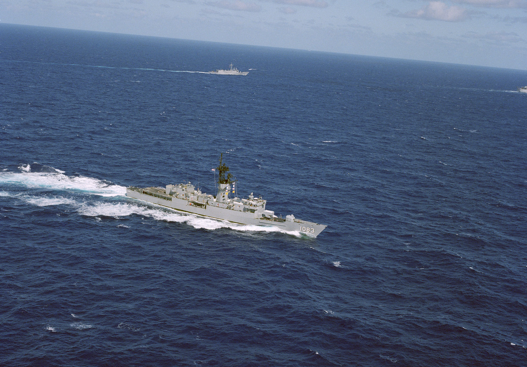 An aerial starboard bow view of the frigate USS COOK (FF 1083) underway.  The guided missile frigate USS JARRETT (FFG 33) is underway in the background