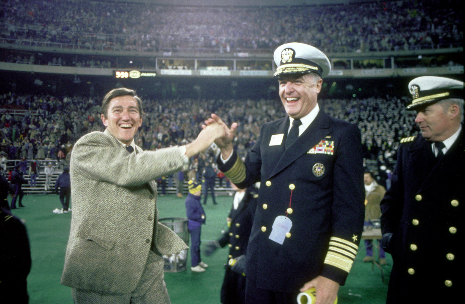 Secretary of the Navy John F. Lehman Jr. congratulates Adm. James D. Watkins, chief naval operations, after the U.S. Naval Academy's 17-7 football victory over Army