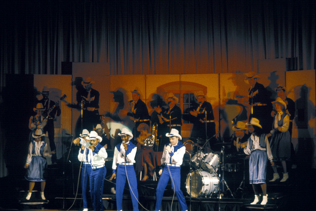 Cathy Clementine and members of the US Air Force Tops In Blue cast sing country music during a performance at the base
