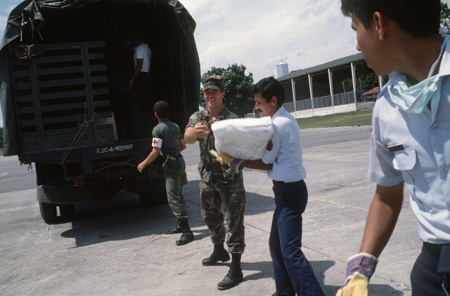 US and Columbian rescue workers load supplies aboard a truck during relief efforts for victims of the Nevado del Ruiz volcano eruption