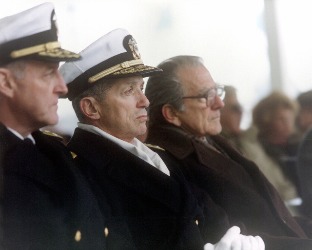 Vice Adm. William H. Rowden, commander, Naval Sea Systems Command, left; Vice Adm. Joseph Metcalf III, deputy chief of naval operations, Surface Warfare, middle, and retired Adm. Elmo R. Zumwalt Jr., former chief of naval operations, sit on the speakers platform during the launching of the guided missile cruiser THOMAS S. GATES (CG-51)
